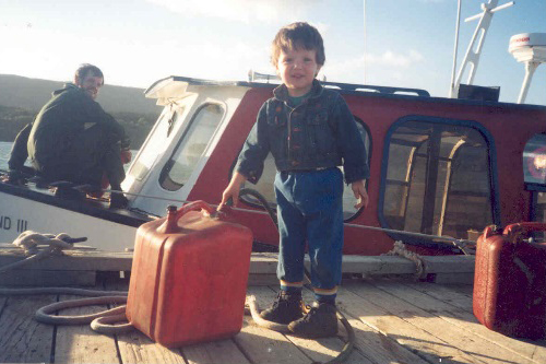 Captain Ian helping fuel up the Eastwind III, circa 1995